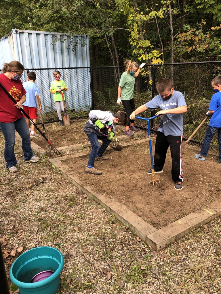 Pack 165 is helping Mrs. Beck turn soil for a fifth grade project!